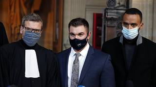 Alek Skarlatos, center, Anthony Sadler, right, and their lawyer Thibault de Montbrial at the Paris courthouse, Friday, Nov. 20, 2020.