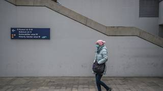 A pedestrian wears a protective mask at the Baross square metro station in Budapest, Hungary, Wednesday, Nov. 11, 2020.