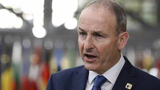 File: Ireland's Prime Minister Micheál Martin speaks with the media as he arrives for an EU summit in Brussels, Friday, Oct. 16, 2020.