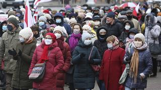 Belarusian pensioners attend an opposition rally to protest the official presidential election results in Minsk, Belarus, Monday, Nov. 23, 2020.