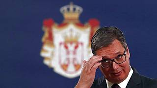 Serbian President Aleksandar Vucic listens to European Commissioner for Neighbourhood and Enlargement Policy Oliver Varhelyi during a press conference in Belgrade, Serbia