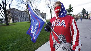 Lisa McClain, a President Trump supporter, walks near the Capitol building in Lansing, Mich., Monday, Nov. 23, 2020.