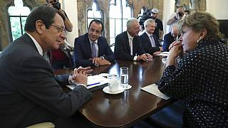UN envoy Jane Holl Lute, right, talks with Cyprus' president Nikos Anastasiades