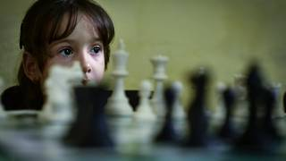 A young girl learns to play chess at the ISLA Higher Instvitute of Chess in Havana, Cuba in November 2016.