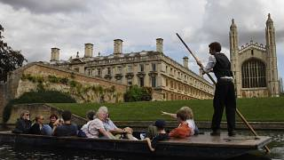 Tourists enjoy a punt on the river Cam, in Cambridge, England.