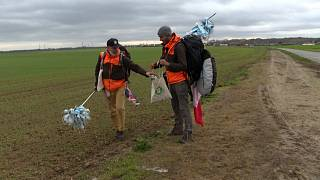 Frédéric and Edmund walking in the open country and collecting rubbish
