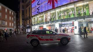 A police car in the area where a stabbing occurred in the department store, in Lugano, Switzerland, Tuesday, Nov. 24, 2020