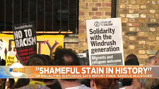 Sign reads 'Solidarity with the Windrush generation' at a demostration in London