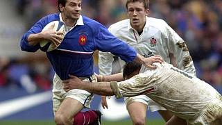 Le rugbyman français Christophe Dominici (à gauche) lors d'un match France-Angleterre le 19 février 2000 - photo d'archives