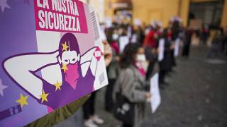 Women take part in a demonstration on the International Day for the Elimination of Violence against Women, in Rome, Wednesday, Nov. 25, 2020.