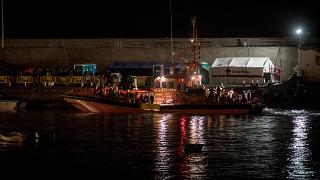 Spanish coastguards dock in Arguineguin carrying over 80 people after their rescue