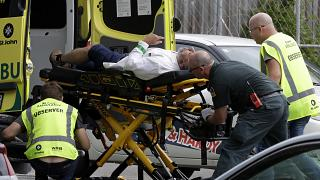 Ambulance staff take a man from outside a mosque in central Christchurch, New Zealand on March 15, 2019.