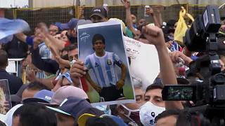 Diego Maradona mourners pushing against police barrier