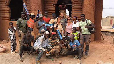 Leila Meroue  Co-Founder of UK charity 'Let's build my school' with locals in Senegal.