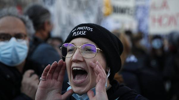 A protester shouts during a demonstration security law that would restrict sharing images of police, Saturday, Nov. 28, 2020 in Paris.