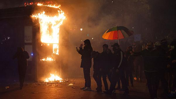A shop burning during a demonstration against the 'global security' draft law
