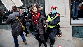 A police officer takes away a protester during the rally
