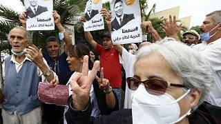 People gather in a show of support to Khaled Drareni,outside the court house Tuesday, Sept.8, 2020 in Algiers.