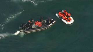 Dinghy with suspected migrants being intercepted by a UK Border Force boat, Aug 2020