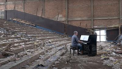 Paul Barton playing piano for wild macaques that live in an abandoned cinema in Lopburi, Thailand.