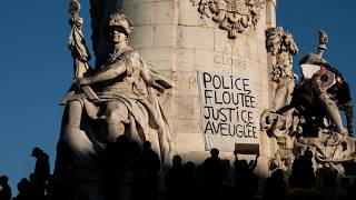 "A banner reading "" Police, blurring, justice blind"" is seen on the statue in the Place de la Republique in ¨Paris, November 28, 2020."
