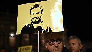 Amnesty International activists take part in a demonstration in Turin on January 25, 2020, to mark the fourth anniversary of Italian student Giulio Regeni's disappearance.