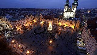 A Christmas tree illuminates the Old Town Square in Prague, Czech Republic, Saturday, Nov. 28, 2020.