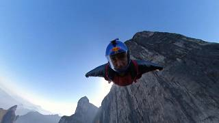 Wingsuit athlete flying to Tianmen Mountain