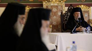 The head of Cyprus Orthodox Church Archbishop Chrysostomos II, right, presides over a meeting of other bishops composing the Holy Synod