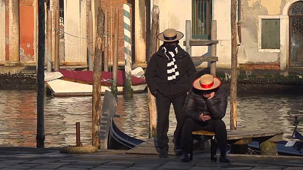 Two gondoliers waiting for clients