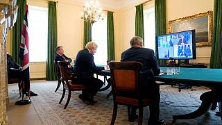 UK Prime Minister Boris Johnson with senior minister Michael Gove and Brexit negotiator David Frost, during a video conference call from London with EU leaders, June 15, 2020.