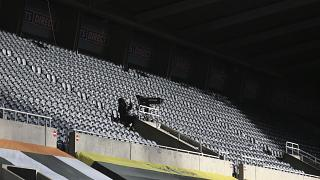 Empy stands at Newcastle United's St. James' Park stadium.