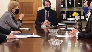 Cyprus President Nicos Anastasiades, center, United Nations Secretary General advisor Jane Holl Lute, left, and Cyprus' foreign minister Nicos Christodoulides, right, meet.