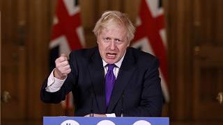 Boris Johnson speaks during a news conference on the ongoing situation with the coronavirus pandemic, at Downing Street in London, Wednesday Dec. 2, 2020.