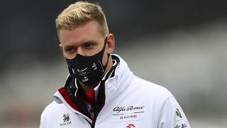 Mick Schumacher of Germany inspects the track prior the German Formula One Grand Prix at the Nuerburgring racetrack in Nuerburg, Germany, Thursday, Oct. 8, 2020. (AP Photo/Mat