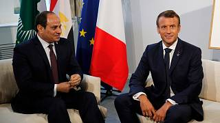 Egyptian President and Chairman of the African Union Abdel Fattah al-Sissi (L) and French President Emmanuel Macron pose prior to their a bilateral meeting in Biarritz, south-