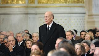 In this Jan. 11, 2010 photo Former French President Valery Giscard d'Estaing arrives for the funeral of Philippe Seguin, the President of the Court of Accounts, in Paris.