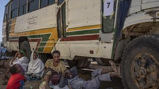 Tigray refugees wait to ride their bus going to Village 8 temporary shelter, near the Sudan-Ethiopia border, in Hamdayet, Dec. 1, 2020.
