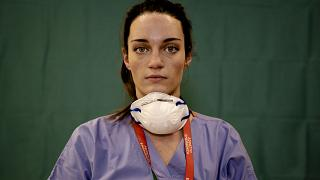 Martina Papponetti, 25, a nurse at the Humanitas Gavazzeni Hospital in Bergamo, Italy, poses for a portrait at the end of her shift on the front lines of the pandemic