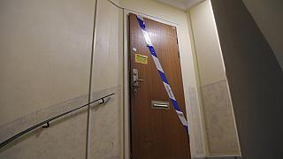 Police tape fixed on the door of the apartment in Haninge, south of Stockholm.