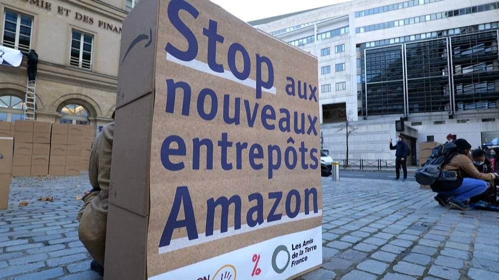 Anti-Amazon protesters demonstrate in front of Paris Finance Ministry