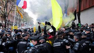 Protesters blocked by riot police during a demonstration Saturday, Dec. 5, 2020 in Paris