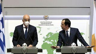 Greek Foreign Minister Nikos Dendias, left, and his Cyprus counterpart Nicos Christodoulides