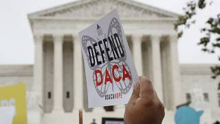 File photo: People rally outside the Supreme Court, Washington, as arguments are heard in the case of President Trump's decision to end DACA. Nov. 12, 2019.