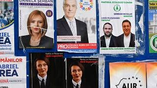 Electoral posters on a board in Bucharest, Romania