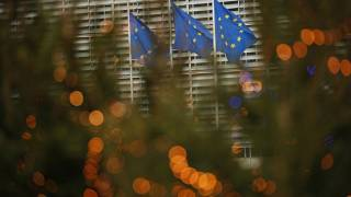 European Union flags flutter prior to a meeting of Britain's chief negotiator David Frost and EU chief negotiator Michel Barnier at EU HQ in Brussels, Sunday December 6, 2020.