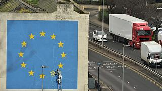 A mural by British artist Banksy, depicting a workman chipping away at one of the stars on an EU flag, is pictured in Dover, south east England on January 7, 2019.