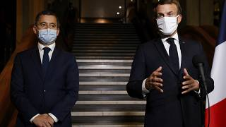 French President Emmanuel Macron (R) and Interior Minister Gerald Darmanin (L) on Oct. 20, 2020.