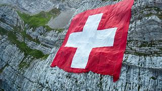 The Swiss flag on a rock face below the Saentis on Friday, July 31, 2020