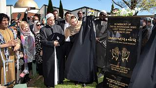 New Zealand Prime Minister Jacinda Ardern unveils a plaque at the Al Noor mosque in Christchurch, Sept. 24, 2020, in memory of the 51 victims of the March 2019 attack.